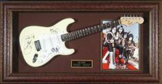 KISS - Group Autographed Guitar Framed Display - Signed Guitars HollywoodMemorabilia,http://www.amazon.com/dp/B008H6WG60/ref=cm_sw_r_pi_dp_v5Setb0T0MS776MS