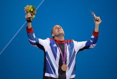 Bronze medallist Matthew Walker of Great Britain on the podium during the medal ceremony for the Men's 50-meter Freestyle S7 final on day 6 of the London 2012 Paralympic Games on Sept. 4. (Dennis Grombkowski/Getty Images) #