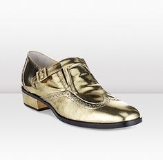 BAY  Jimmy Choo  This shining gold vintage mirror leather shoe with fine brogue detailing gives a playful feminine twist on a classic men's shoe.