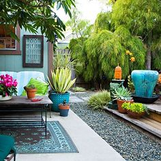 Great small patio & enclosed yard. Has a sort of European feeling. Notice the interesting contrast of textures & tone on tone shades of green- from yellow to blue.