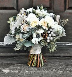 Do you like the Silver Brunia?  It is the grey berries in this bouquet.
