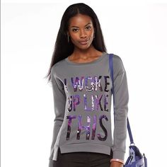 NWT Juicy Couture Graphic Sequence Gray Sweatshirt PRODUCT DETAILS Elevate your lounge-wear with this women's  Juicy Couture sweatshirt. Embellished front, bold graphics and soft French terry construction combine casual and couture for a unique look you'll love.   PRODUCT FEATURES  Vented, drop-tail hem Crew neck Long sleeves  FABRIC & CARE  Cotton/polyester Hand wash Imported Juicy Couture Tops Sweatshirts & Hoodies