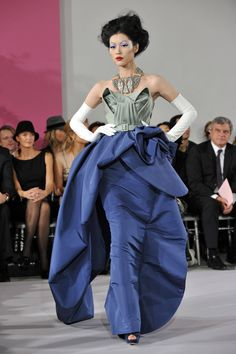 A model shows off a gown at the John Galliano collection at Paris Fashion Week Haute Couture spring/summer 2010 show.