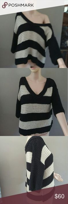 Loose cable knit off shoulder sweater. 3/ 4 sleeves. Hi low cut by a cple inches. Never worn Free People Sweaters V-Necks