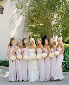 Bridesmaids in long blush dresses..