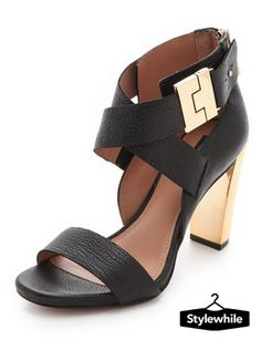 Soft leather heels from Rachel Zoe shine with a warm metallic acrylic heel, while the crossover ankle straps and inset footbed lend a touch of sculptural sophistication. A polished buckle accents the ankle, and an exposed zip closes the heel cap. Leather sole. www.stylewhile.com
