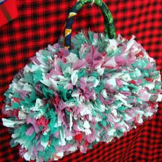This is so cool. recycled plastic bags fashioned into handbags by workers in Dar es Salaam.