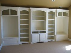 This is PERFECT for our girls playroom!!!!! playroom entertainment center but with more closed cupboards to hide toys -