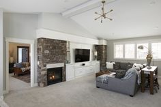 Zawadski Homes - Dream Home. Family room outfitted with entertainment center with see-through stone fireplace. Custom Home Builders, Custom Homes, Dream Home Builder, Entertainment Center, Home Projects, Luxury Homes, Family Room, Stone, Home Decor