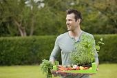 KY389049 Man holding a tray of raw vegetables