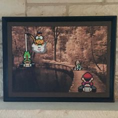 That's definitely me on the left. :). Always falling off the road in Mario Kart. More cool art made out of random thrift store finds. by @thepixelizedprincess
