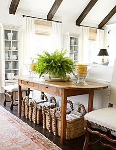 white wall, dark floors, and dark beams with natural wood furnishings add great contrast and warmth.
