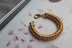 """DIY: Jump Ring """"Coil"""" Bracelet Glue // 300 or so Brass Jump Rings // Clasp Two Brass Barrel End Caps // Rope (use about less than you'd like your bracelet to be) Diy Bracelets Easy, Bracelet Crafts, Cute Bracelets, Ring Bracelet, Beaded Bracelets, Jewelry Crafts, Diy Schmuck, Schmuck Design, Diy Jump Rings"""
