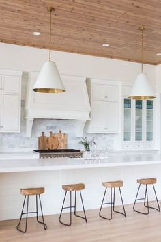 contemporary white, timber, gold kitchen