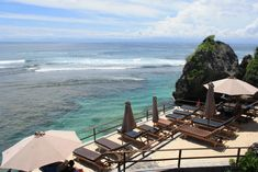Overlooking the famous surf breaks at Uluwatu in southern Bali, Single Fin offers hearty meals, bottles of the local beer, Bintang, and a huge wooden sun deck looking over the Indian Ocean. It has a relaxed vibe in the daytime, with people coming to enjoy coastline views while watching the pro surfers in action below. On Sunday evenings, the bars hosts live acoustic bands and DJs.