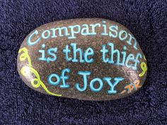 Comparison is the thief of joy -TR. Hand painted rock by Caroline. The Kindness Rocks Project