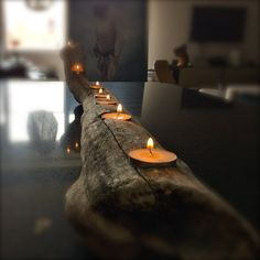 Made from reclaimed drift wood from the Mississippi River.  Measures approximatly 4 feetwith 7 spaces for tea lights. Each piece will be completly unique, thus will vary from the picture shown. Designed and made byDraeger Handcraft. Please allow 7-10 days for delivery.