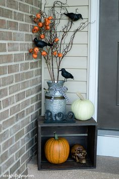 Halloween Front Porch Ideas. Crows, Pumpkins and Skulls.