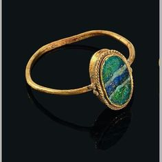 """Ancient Gold Roman Ring-With Glass Stone-This glass has been made to resemble a natural stone.The author suggests that the glass was made to imitate agate-but because of chemical changes throughout time,the """"agate"""" has more resemblance to an opal!!"""