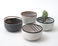 Hanna Kruse was influenced by Ikebana, the traditional Japanese art of flower arrangement, when designing the little ceramic vessels.