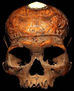 DAYAK CARVED: HEAD HUNTING HUMAN TROPHY SKULL #20  HAND CARVED HUMAN BONE AND SHELL  THE DAYAK TRIBE, FROM BORNEO ISLAND  INDONESIA, CARVE DESIGNS INTO THE SKULLS  OF THEIR HEADHUNTED VICTIMS AND INSERT WOODEN FIGURES.