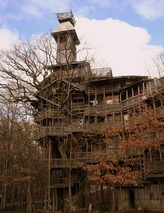 The Minister's Treehouse was built by a preacher named Horace Burgess who claims to have been inspired by God. He has been building it for over 20 years. It's braced by six trees, is ten floors and is nearly 100 feet tall. The inside is a Escher-like maze full of secret runs and tunnels. Crossville, TN