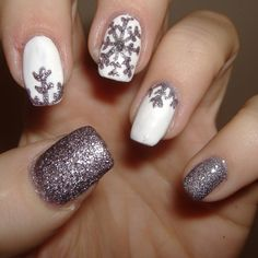 These snowflake winter nails could probably be DIY! #WinterNails #WinterStyleFile #winterfashion2017