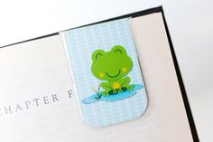 This cheeky frog would be happy to keep your page!  So…..you are probably wondering WHY you need to get a laminated magnetic bookmark from my shop. My products have some perks; please, allow me the opportunity to enlighten you!  - They are hot laminated, fully protecting the paper bookmark on the inside. This means that if you spill your coffee on it (never!) or a lovely little one dunks it in a glass of milk (not MY child!), no problem! Just wipe it off and you are good to go! - I know from…