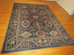 "Oriental Weavers of America made oriental pattern area rug ""The Nile"" 7'8""x10'10"" in very good condition."