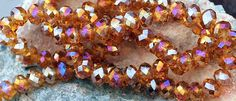20 pcs 6x4mm Transparent Dark Gold Amber Firepolished with Fuchsia AB Rondelle Faceted Glass Beads by RainandSnowBeading on Etsy