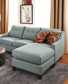 Contemporary and stylish, the Madison Place sectional will transform your living room. Covered in cool hydra colored Microfiber Plush, the sectional features track arms and loose tufted pillowbacks.