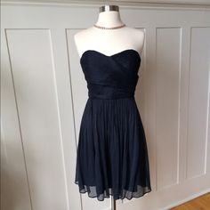 Navy Silk JCrew Strapless Dress Elegant Navy Silk Dress from Jcrew.  Worn once to a wedding and it was stunning!  Very flattering lines with built in bodice/support so can be worn without a bra, an added plus! Size 4.  Perfect condition. J. Crew Dresses Strapless