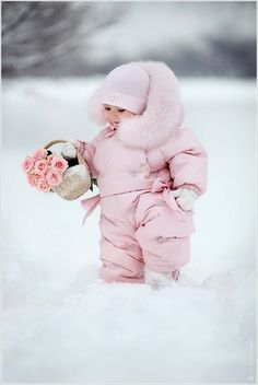 Little girl in a big fluffy pink snowsuit, with a basket of roses in her hands | white, snow, winter, hat, gloves, Retykle