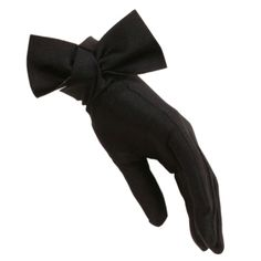 BLACK | Short black cocktail gloves with a pristine side bow at the wrist. Made from satin lycra, the gloves are stretchy, ensuring a snug, flattering fit.