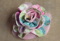 SnowyBliss: Fabric Roses... without the stems! Love this idea for wreaths... Cheaper