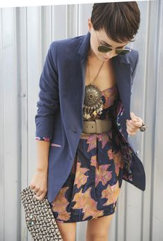 # Glamorous combination: Aviators, chunky statement piece, taupe belt, strapless dress, blue blazing