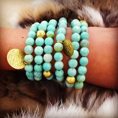 This is a handmade bracelet made with 8mm faceted agate beads. The coins are from Greece and are traditionally used on costumes for Greek dances.