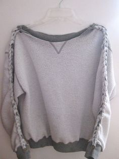 DIY Braided Sweatshirt... AWESOME way to reuse that old sweatshirt you NEVER wear!