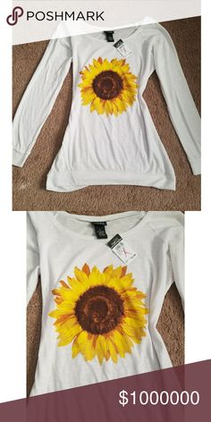Free giveaway! 🌻 Sit tight, spring will be here before you know it girls! Start building that easy spring/summer wardrobe here on posh! First buyer of the new year will receive this fun sunflower print shirt! Happy poshing to all my girls, & a blessed new year! 🌻 Rue 21 Tops Tees - Long Sleeve
