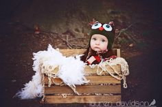 Infant photo shoot. Baby photo ideas. Baby boy pictures. Infant with crocheted owl hat in basket with moss, yarn, and feathers. 6 month photo ideas. 9 month photo ideas. Crocheted hat prop. Lauren Davidson Photography.