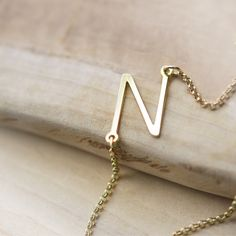 Colliers – 18k Yellow Gold Plated Sideways Initial Necklace – a unique product by Bijoux-Personnalises on DaWanda