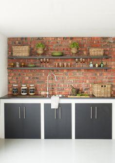exposed brickwork with brown-black colour scheme