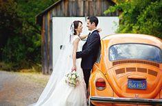 Bride and groom with vintage VW beetle wedding car