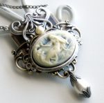 ---> my store compass steam locket A beautifully, stylized emblem that depicts the four cardinal directions is the focal ornamentation of this pendant. Inside are decorative cog 'n' gear working...