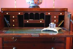 Carla's antique butler's desk. Displayed on top are 17th century brass candlesticks and a large Imari bowl from Tokyo.