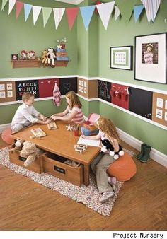 love the chalk boards and cork boards in this playroom