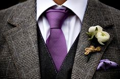 groomsmen suits and ties! grey suits and purple tie and pocket square with green flower instead of white!