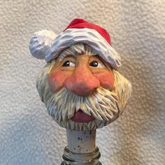 Santa bottle stopper carved by RWK Woodcarving.