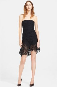 I love the unusual hem of this black lace party dress by Nina Ricci. The ruching is so flattering to all silhouettes and the fabric is a combination of soft and stretchy. I saw this at Nordstrom. Beautiful but expensive....$4300. Perfect for the AmericanWoman.