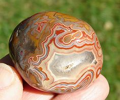 Fairburn agates are marine sedimentary agates noted for their typically bold banding with sharp peaks and curves. Weathering has often exposed the fortification patterns. The elusive Fairburn is the state gemstone of South Dakota.